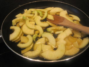 Combine apples and 2 cups apple juice in medium skillet.