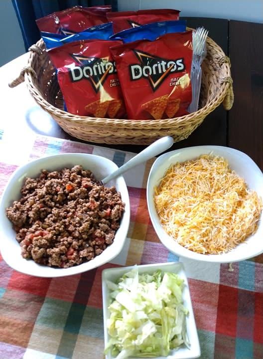 walking tacos ingredients in bowls